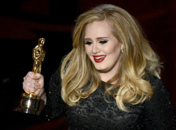 Adele celebrating Oscar for song Skyfall. photo credit: zimbio.com