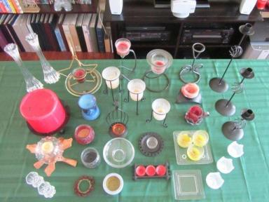Collection of candle holders, many in use