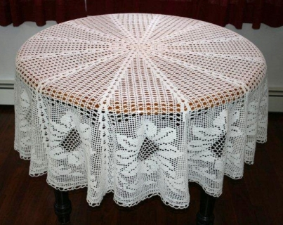 Table cloth crocheted by Mom in hundreds of hours