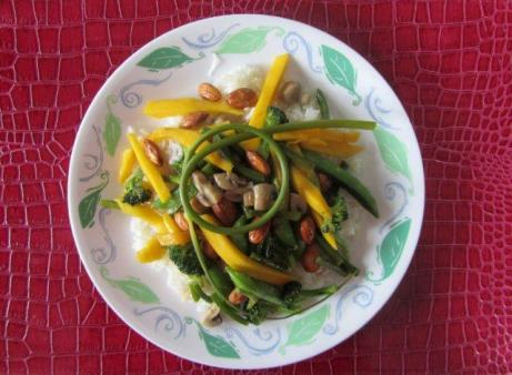 Stir fry with almonds, mangoes, mushrooms and scapes