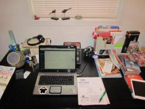 Current state of my desk top (somewhat tidied for photo): includes bills, coupons, receipts, programs, tickets, lists, cookbooks, book, etc.