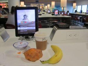 iPad lounge at LaGuardia (and my breakfast!)
