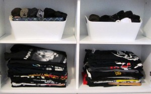 Rom's stuff: on top, 2 bins of socks. Below: two shelves of rock T-shirts