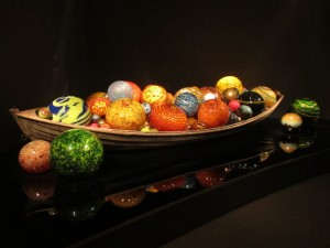 14 foot boat with blown glass the size of beach balls