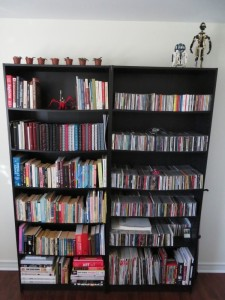 Bookshelves with books, CDs, C3PO and R2D2 models