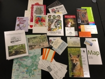 Paper mementos including tickets, greeting cards, tourist pamphlets, boarding passes and maps